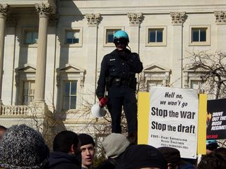 While we demonstrated, Capitol Police officers stood up high, holding bullhorns.