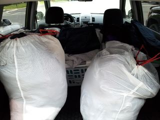 Getting rid of a bunch of old clothes on April 14. The bags contained clothes that were going to the Shady Grove Transfer Station for recycling, and then the baskets contained clothes that would be donated to Goodwill.