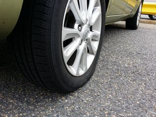 On August 6, I picked up a piece of road debris with my right rear tire. I had come off of the Intercounty Connector near Laurel, and noticed that my tire light had come on. When I pulled into a shopping center to investigate, I heard a hissing sound.
