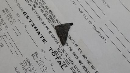 I was on my way again in less than an hour, after they had extracted the piece of metal seen below, and patched the hole.