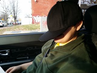 On December 13, I was out with Elyse practicing a few bus routes in the car. I got a few silly photos of her wearing a baseball cap while we were out.
