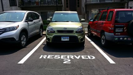 On July 7, I finally got a reserved parking space. I now had my own spot directly in front of the door, and no longer had to hunt to find a parking space when I came home late at night. This would be my space for a little more than two years.
