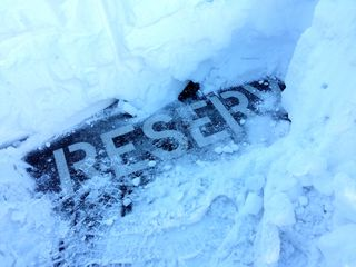 """Two milestones in the snow removal: finding the """"reserved"""" marking in my parking space, and finding the hood of the car."""