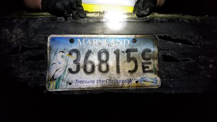 Elyse found the fire-damaged front bumper on the side of the road, with the license plate still attached and green paint still visible. The Kia emblem from the hood was stuck to the back.