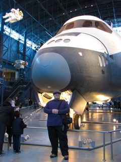 Standing in front of Space Shuttle Enterprise at the Smithsonian Udvar-Hazy Center.