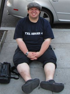 Sitting on the sidewalk in Dupont Circle (top), after having just walked from the White House to Union Station (and then taking the Metro back around). My pants are rolled up because my heels had become irritated from all the walking (almost two miles!), and both the back straps on my Crocs and my pantlegs were aggravating it. So I moved both out of the way (below). I looked ridiculous, but I also didn't care.
