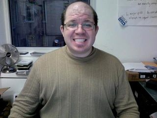 Wearing a mock turtleneck shirt that fits.