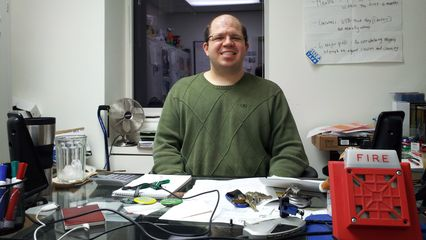 Wearing a sweater that fit and smiling while my office Mac got serviced for a moment. Interestingly enough, when I posted this photo on Facebook, the discussion quickly centered around fire alarms due to the presence in the photo of the Wheelock 7002T that lives on my desk. This was much to the surprise of a coworker who commented prior to when the discussion about alarms began.