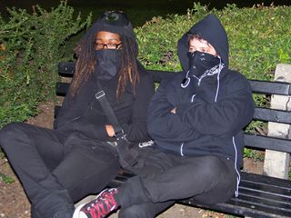 Masked up in full black bloc, and waiting for the action to begin.