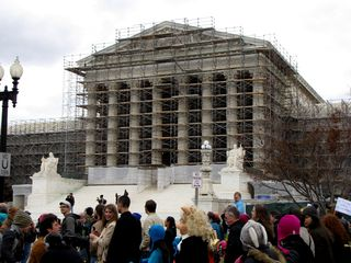The exterior of the Supreme Court Building was under renovation at the time of the demonstration. The scaffolding normally was covered by a picture of the building, but presumably due to Hurricane Sandy, which came through four days prior to this event, this covering was missing.
