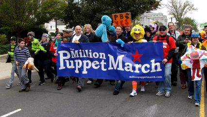 The march heads north on First Street NE.
