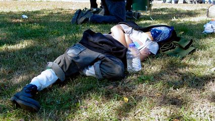 Even with all the events going on, some people just pulled their bandanna up over their eyes and took a nap.