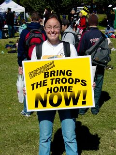 """This protester provides criticism of the war on terror in a different way, using the popular slogan of """"Bring the troops home NOW!"""""""