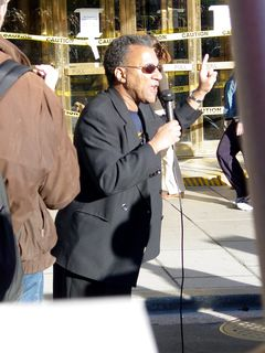 A number of people gave short speeches in front of the Hotel Washington, including Larry Holmes.