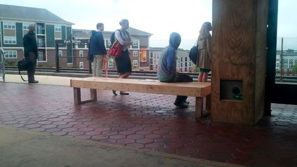 While Metro was doing platform reconstruction at Fort Totten, the regular benches were replaced with these wooden ones.