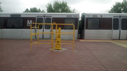 Platform reconstruction work underway at Takoma station. Note the hole where a pylon should be.