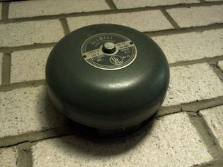 """A few folks had wanted to know what the fire alarm notification appliances looked like in my apartment building, and so this is the one outside my door. My apartment building uses Ellenco """"EllBell"""" bells that run at 120VAC. My building has a very old fire alarm system, likely never having been upgraded since it was built."""