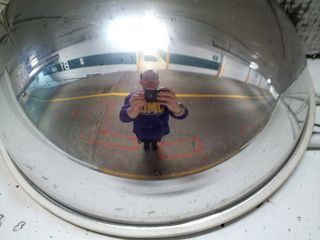 Self-portrait off a mirror in the parking garage at the office.