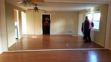 We found this mirrored wall in a townhouse in Aspen Hill. The mirrors covered a cinderblock wall. Talk about a rock and a hard place. I hated those mirrors, but a cinderblock wall was even worse.