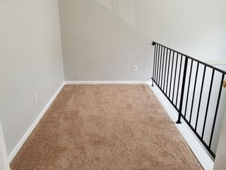 For a back-to-back, it had lots of light, a very spacious main level, the stairs were open with a skylight at the top, and the master bedroom had its own skylight and a den overlooking the living room with a two-story window in front of it.