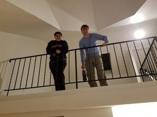 Brian later came over to see the place, and I got this photo of them looking down from the mezzanine.