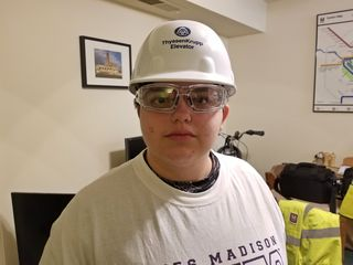 Elyse suited up to join me in removing the wallhangings from the living room. Yes, she really did wear a hard hat and safety glasses.