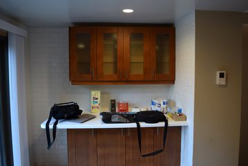 The kitchen and breakfast bar.