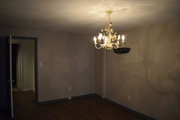 Elyse's room, complete with ugly chandelier. Also, yes - that is the Sable's old grille on the wall in one of the photos.
