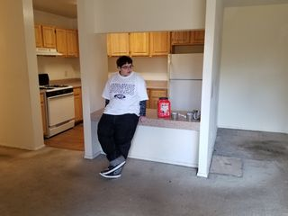 Elyse looks around at the now-empty apartment.
