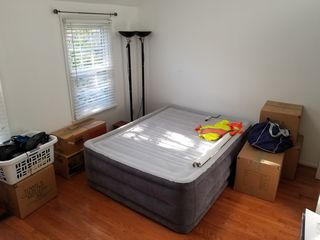 Boxes and such in my bedroom, placed around the air mattress.