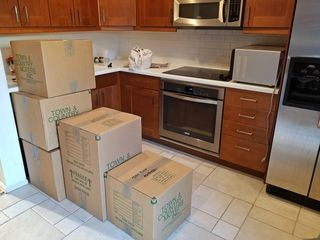 Boxes in the kitchen. Getting the kitchen fully operational would be the first order of business for me after the movers left. All dishes, glassware, and silverware would go through the dishwasher before being put away.