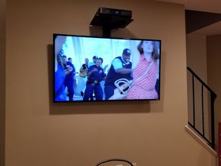 On December 7, we got a new television up on the wall with help from Aaron Stone.