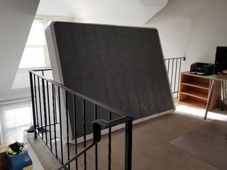 The next thing to come together was the bed. I ordered a Zinus box spring on Amazon, and I assembled it up in the mezzanine. The idea was that because the mezzanine had carpet, I wouldn't risk accidentally damaging the wood floors below during assembly. However, getting that massive box spring down the stairs was a challenge - but I managed.