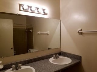The bathroom, about as clean as we could get it, with the original incandescent light bulbs from 2007 back in place. Yes, I saved those bulbs for over a decade in order to put them back when I left.