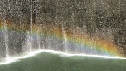 The footprints of both of the old Twin Towers were made into fountains. On this sunny day, I used the polarizing filter on my camera to bring out a rainbow in the spray from the North Tower's fountain. I thought it seemed quite fitting.