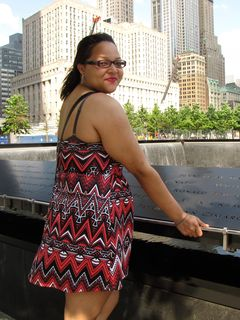 Doreen stands next to the North Tower fountain. The names of the victims of the September 11 attacks are inscribed on bronze plates ringing both fountains.