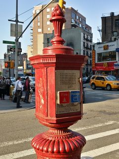 On our way back to the subway, I spotted a New York fire and police call box. I was expecting a system similar to that which I saw in Boston, i.e. Gamewell telegraph boxes, so this was a surprise. Apparently, you lift the cover for the service that you need, press a button, and then speak into the box after someone answers.