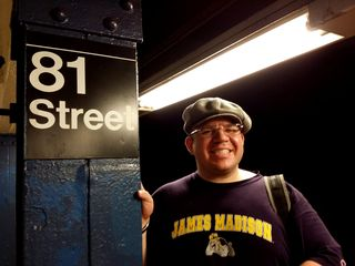 When we got to 81st Street, Doreen got a photo of me with one of the signs on the columns. Unlike DC Metro pylons, these are much easier to pose with.