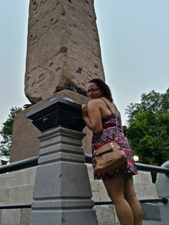 Doreen poses for a photo with the obelisk.