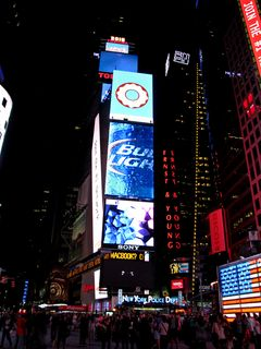 """One Times Square, with """"2015"""" in lights at the top of the building."""