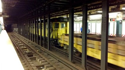 I spotted a work train going through on the uptown express track. I want to say that the yellow subway car that's part of this train is a former Redbird.