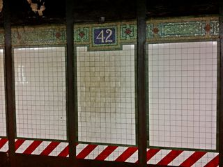 Tilework on the trackside wall at 42nd/Times Square.