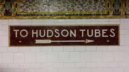 """""""TO HUDSON TUBES"""" sign on the wall at Cortlandt Street, directing passengers to the PATH trains."""