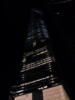 One World Trade Center at night. The difference in lighting between the upper and lower floors struck me as interesting. The reason for the difference is because the lower floors appear to have had buildouts for tenants, while the upper floors are completely empty, having not yet been built out for tenants.