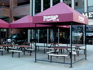 This is where we spent a few moments to get out of the rain, seen here in this June 6, 2006 file photo. We stayed under the double canopy in the back, and pushed the tables together to ensure that we stayed out of the rain.