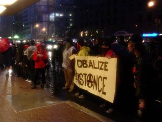"""We certainly made quite a statement, with our group all lined up along the sidewalk, with our """"Globalize Resistance"""" banner prominently displayed."""