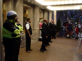 Meanwhile, hotel staff and the police guarded the hotel doors, to keep the demonstrators out of the building.