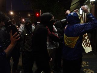 When some members of our group realized that we'd caught the hotel off guard, part of our black bloc marched directly into the hotel's lobby.