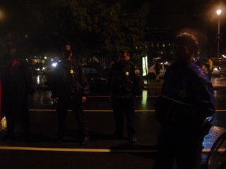 The police, meanwhile, stood guard not only at the hotel's entrance, but around the outside of our demonstration as well.