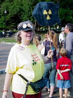 Carol Moore holds up her sign, designed to look like a nuclear bomb.
